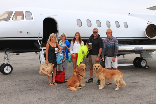 Family and Dogs boarding Private Jet